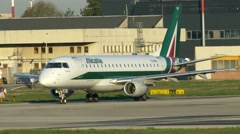 0669 UHD Alitalia commecial plane moving to runway Stock Footage