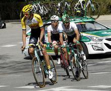 Steven Kruijswijk, Lluis Mas and Fumiyuki Beppu riding Stock Photos