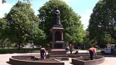 Stock Video Footage of Queen Victoria ChristChurch New Zealand Workmen fixing EarthQuake Damage