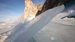 Shoot with slider using on Baikal lake in Russia ice Stock Footage