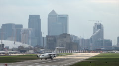 Avro RJ85 cityjet plane taxis on runway at London City airport, England Stock Footage