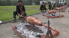 Pigs on skewer Stock Footage