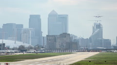 Flybe De Havilland Dash 8 plane lands at London City airport, England Stock Footage