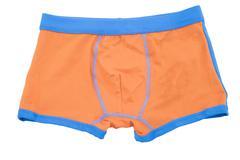 Children's orange swimming shorts isolated on white background. - stock photo