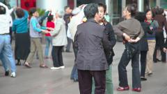 People dance on the street in Shanghai Stock Footage