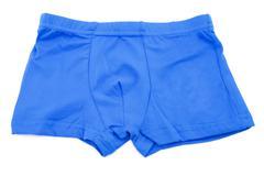 Children's blue swimming shorts isolated on white background. - stock photo