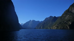 New Zealand Milford Sound distant waterfall pan toward wall Stock Footage