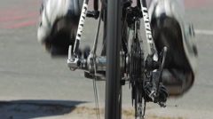 Cyclist practicing before the start of the crit race. Rear view, slow-motion. Stock Footage