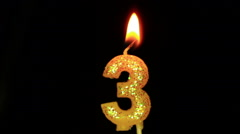 Candle in the form of three - stock footage