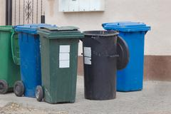 Rubbish bins waiting to be empied Stock Photos