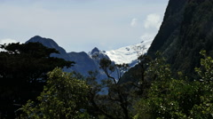 New Zealand Milford Sound shadowy face and snowy peak Stock Footage