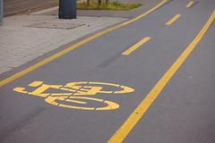 Bicycle lane sign on asphalt surface Stock Photos