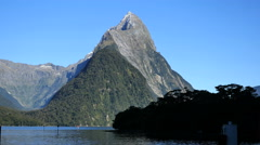 New Zealand Milford Sound Mitre Peak and island from dock Stock Footage