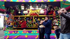 Stock Video Footage of One side of dart throw at balloons in carnival game