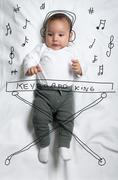 Cute baby boy decorated as a pianist Stock Photos