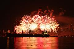 Fireworks over the water - stock photo