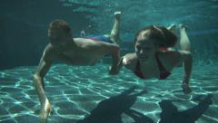 Couple Swimming Underwater Slow Motion - stock footage