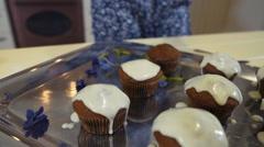 Close up feminine hands adding cream on the cupcakes - stock footage