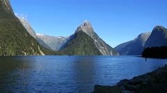 New Zealand Milford Sound Mitre Peak and jetty stones Stock Footage