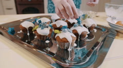 Stock Video Footage of Close up feminine hands decorating cupcakes