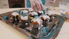 Close up feminine hands decorating cupcakes - stock footage