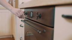Feminine hand switch on old fashion oven Stock Footage