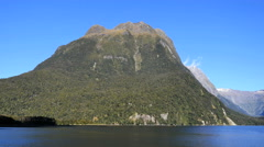 New Zealand Milford Sound pan from square peak to Mitre Peak Stock Footage