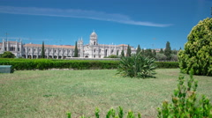 The Jeronimos Monastery or Hieronymites Monastery with lawn and bushes is Stock Footage