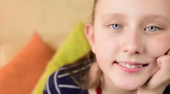 Facial expression of a beautiful blue eyed, blonde teen girl, smiling  Stock Footage