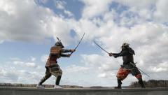 the duel of two Japanese samurai against the sky with clouds - stock footage