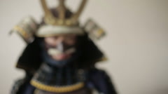 Ancient Japanese samurai menacingly posing, close up, white background Stock Footage