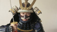 Ancient Japanese samurai with katana menacingly posing, close up, white Stock Footage