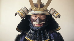 Ancient Japanese samurai opens up his sword, close-up Stock Footage
