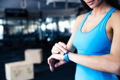 Woman using activity tracker - stock photo