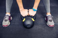 Woman working out with kettle ball Stock Photos