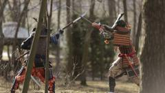A battle between two samurai in the forest Stock Footage
