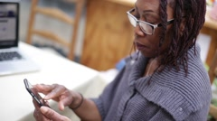 Techy-Savvy Mother Uses Smart Phone Stock Footage