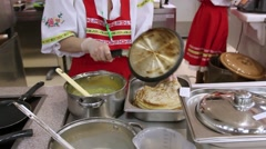 RUSSIA, MOSCOW, 7 MARCH 2015, Young woman chef in russian traditional costume Stock Footage