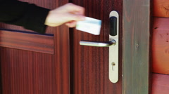 The man opens the door to an electronic key - card Stock Footage