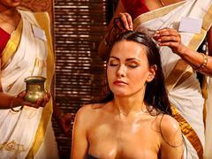 Woman having ayurveda spa treatment - stock photo