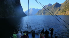 New Zealand Milford Sound bow of boat over blue water Stock Footage