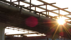 Factory production tubing at sunset (2) Stock Footage