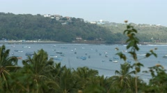4K shot of Coastline in Goa with Palm Trees & Boats Stock Footage