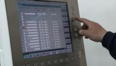 Worker control cnc machine, typing on the monitor and keyboard, set the function Stock Footage