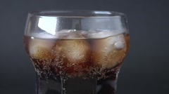 Soft drink, bubbless, ice on dark background. Stock Footage
