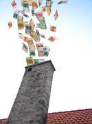 euros flies down the chimney - stock photo