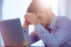 Businessman using laptop at desk Stock Photos