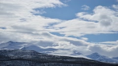 clouds moving on blue sunny spring sky over majestic mountain in the north - stock footage