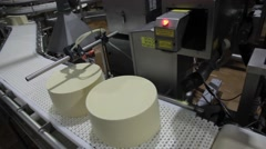 Laser puts the production date on the cheese Stock Footage