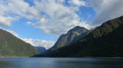New Zealand Milford Sound mountains near sound entrance from boat Stock Footage